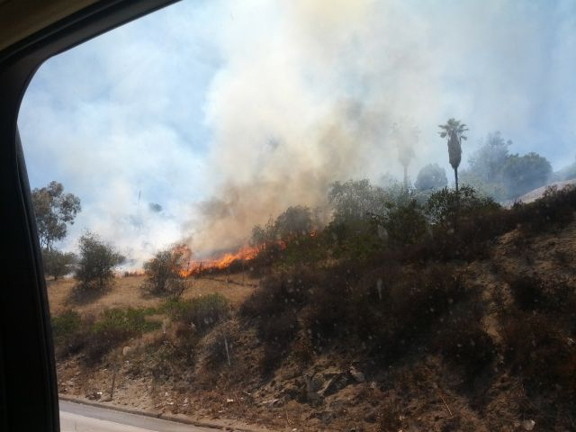 [Snapshot: brush fire in La Mesa off CA 125]