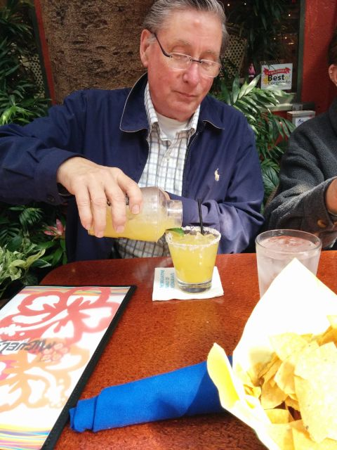 [Snapshot: it's not a birthday lunch unless Dad spills his margarita.]